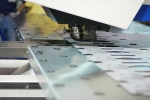Stamping holes in large metal sheet